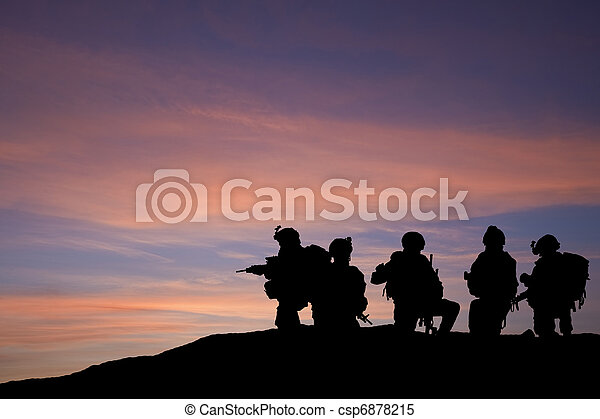 Silhouette of modern troops in Middle East silhouette against be - csp6878215