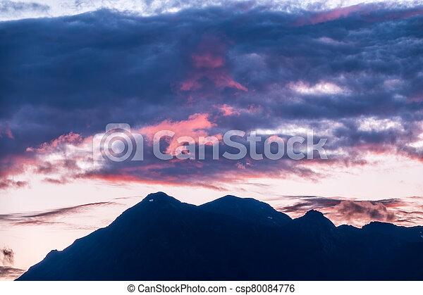 Silhouette of mountain range at pink sunset - csp80084776