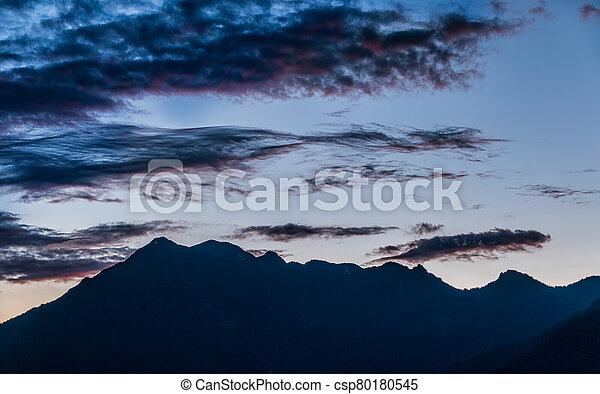 Silhouette of mountain range at sunset - csp80180545