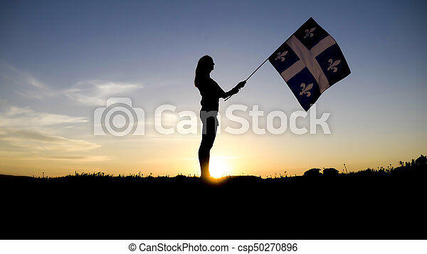 silhouette of people with flag on mountain top . - csp50270896