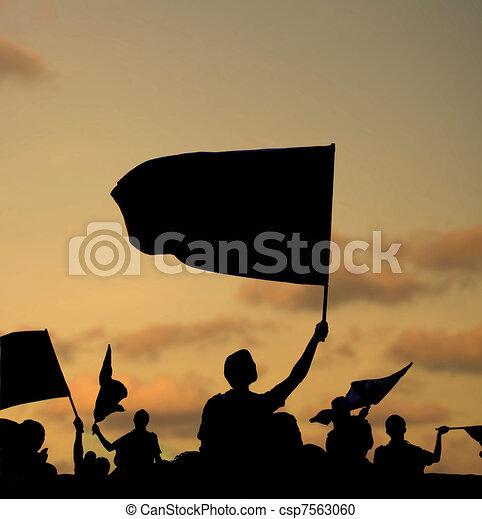 silhouette of protestors - csp7563060