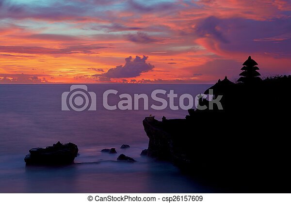 Silhouette of Pura Tanah Lot at coloured sunset. - csp26157609