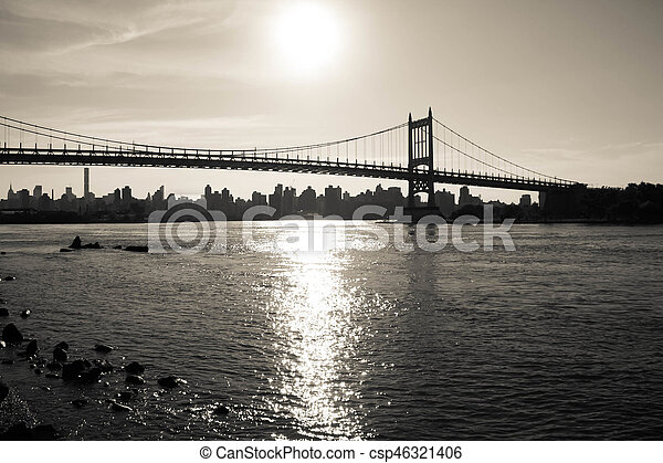 Silhouette of Triborough bridge over the river and the city in dark vintage style, New York - csp46321406