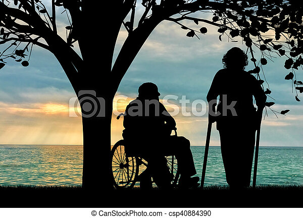 Silhouette of two people with disabilities - csp40884390