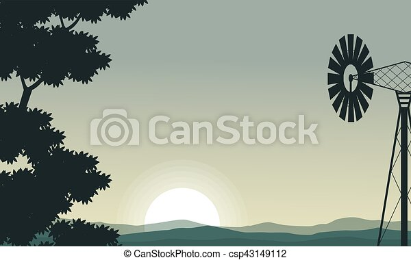 Silhouette of windmill and tree on the morning - csp43149112