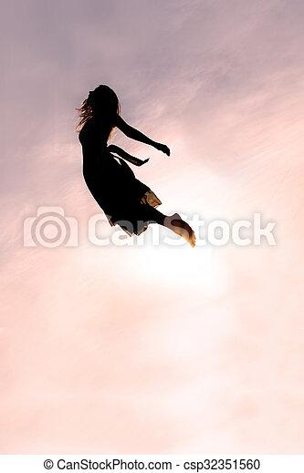 Silhouette of Woman Falling through Sky - csp32351560