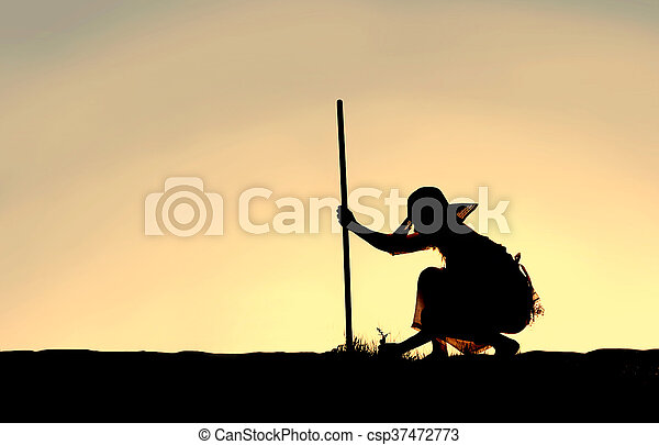 Silhouette of Woman Pulling Weeds from Garden - csp37472773