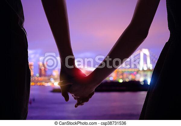 silhouette romantic lovers with Odaiba - csp38731536