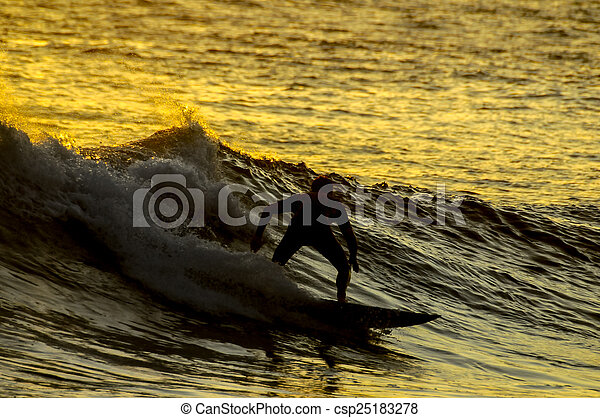Silhouette Surfer at Sunset - csp25183278