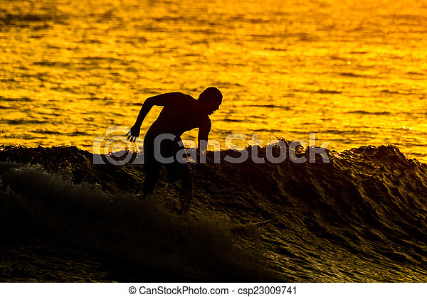 Silhouette Surfer at Sunset - csp23009741