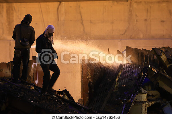 Silhouettes of  firemen before a fire - csp14762456