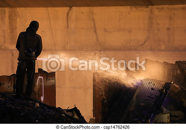 Silhouettes of  firemen before a fire - csp14762426