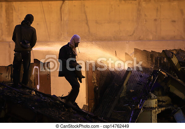 Silhouettes of  firemen before a fire - csp14762449