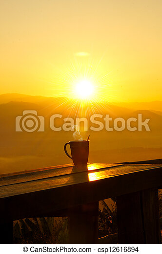 Silhouettes on sunrise morning coffee. - csp12616894