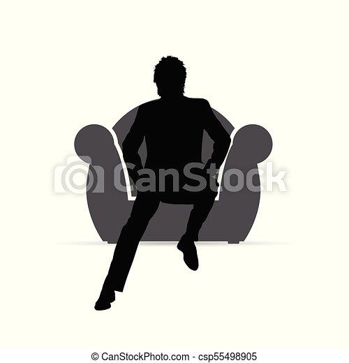 El hombre sentado en la silueta del sillón - csp55498905