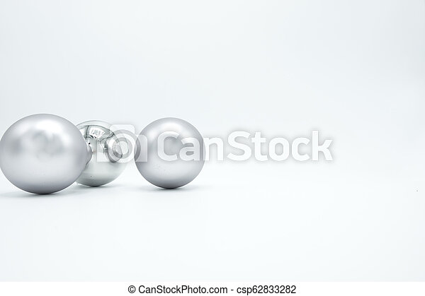 Silver Christmas balls on white. - csp62833282