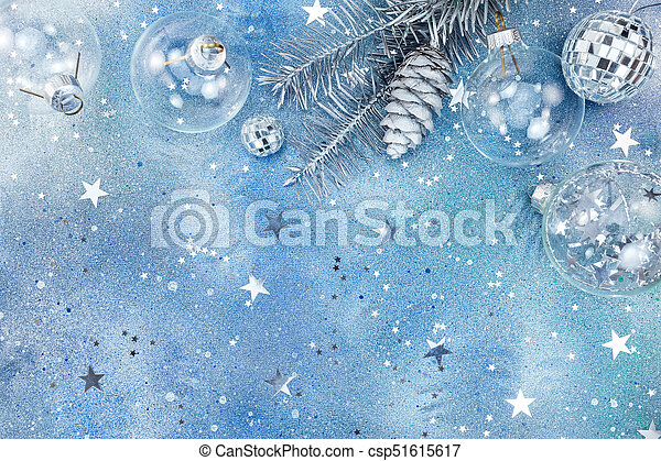 silver christmas decorations on glitter background with star confetti csp51615617