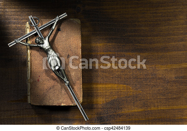 Silver Crucifix and Holy Bible on Wooden Background - csp42484139