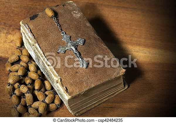 Silver Crucifix Rosary Bead and Holy Bible - csp42484235