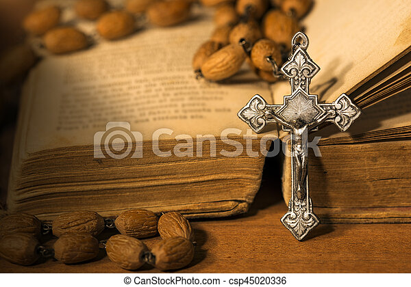 Silver Crucifix Rosary Bead and Holy Bible - csp45020336