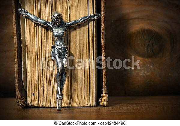 Silver Crucifix with an Old Holy Bible - csp42484496