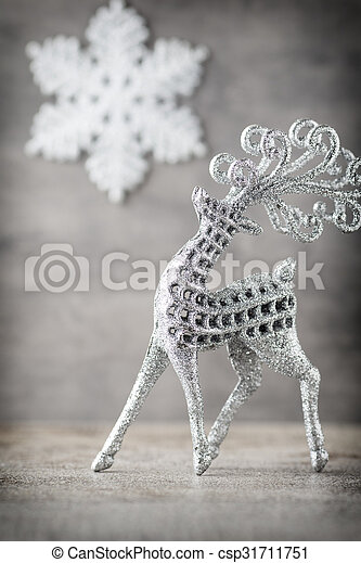 Silver deer on gray background. Christmas background. - csp31711751