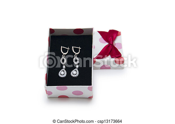 Silver earrings in a box isolated on white background - csp13173664