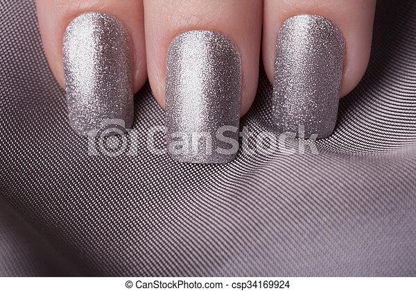 Silver nail polish. Very beautiful silver metallic nails closeup.