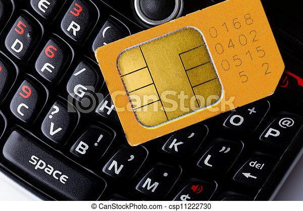 Sim card on smart phone keyboard - csp11222730