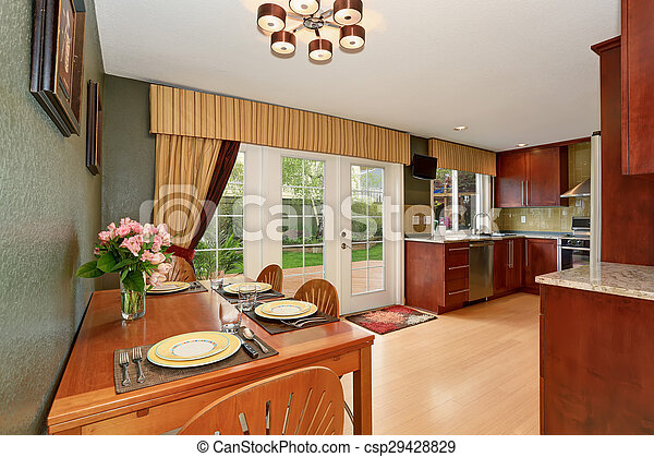 Simple dinning area with connected kitchen. - csp29428829