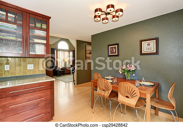 Simple dinning area with connected kitchen. - csp29428842
