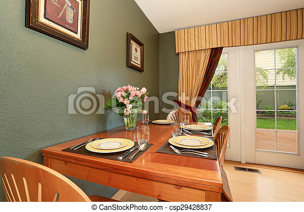 Simple dinning area with connected kitchen. - csp29428837