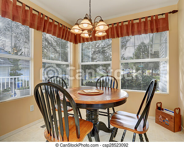 Simple dinning room with tile floor. - csp28523092