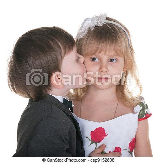 Sincere kiss a little boy in suit kisses a little girl in a sincere kiss csp9152808 altavistaventures Images