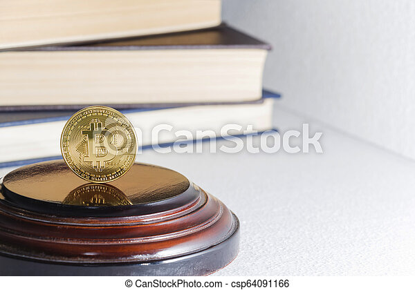 Single bitcoin coin or icon standing in sharp focus on a reflective surface with gold colored - csp64091166