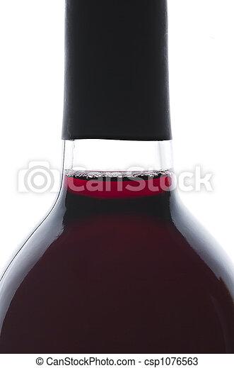Single bottle of backlit red wine - csp1076563