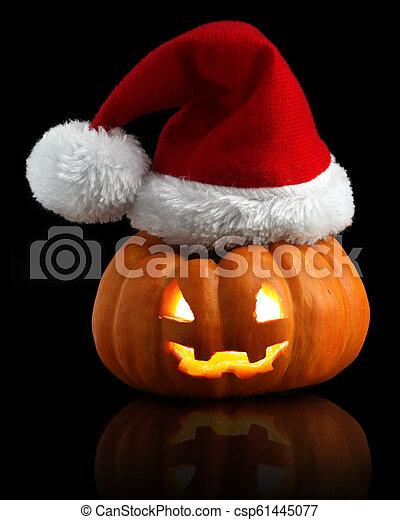 637c346370e Single orange pumpkin Jack-o-lantern with Christmas Santa hat - csp61445077