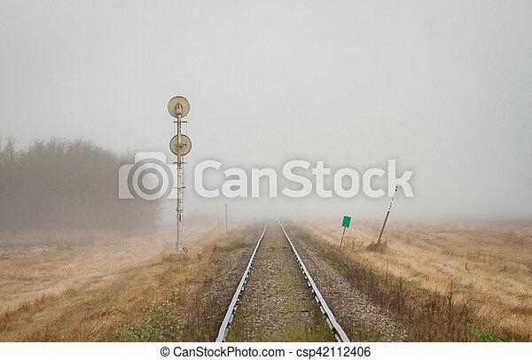 Single Railroad Track Receding into Fog - csp42112406