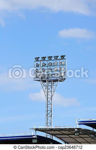 Single spot-light pole with blue sky in stadium - csp23648712
