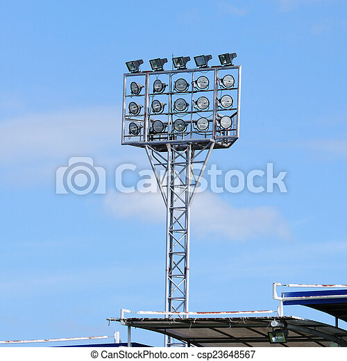 Single spot-light pole with blue sky in stadium - csp23648567