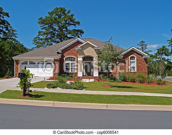 Single Story Brick Residential Home Stock Photo