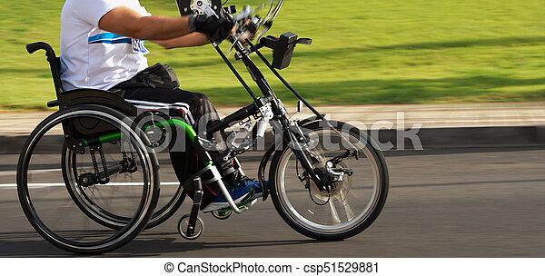 Single wheelchair athlete in action during a marathon - csp51529881
