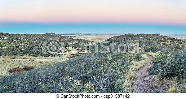 singletrack bike trail and rolling prairie - csp31587142