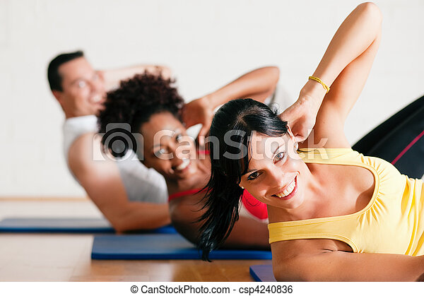 Sit-ups in gym for fitness - csp4240836