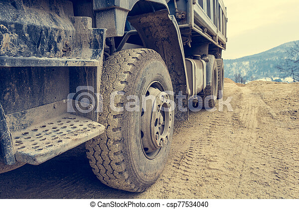 Site view detail of a parked construction truck. - csp77534040