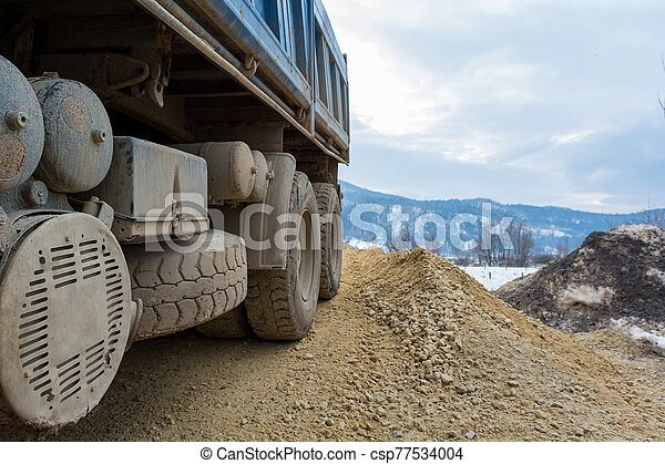 Site view detail of a parked construction truck. - csp77534004