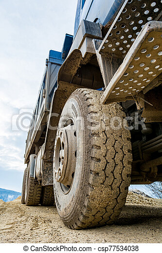 Site view detail of a parked construction truck. - csp77534038
