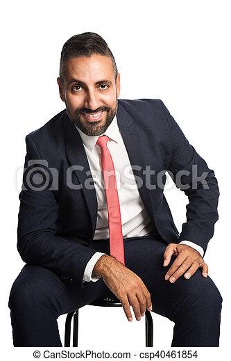 Sitting businessman smiling - csp40461854