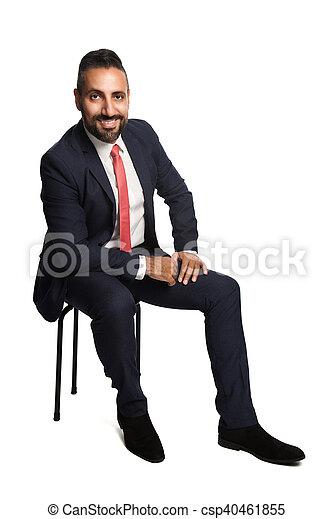 Sitting businessman smiling - csp40461855