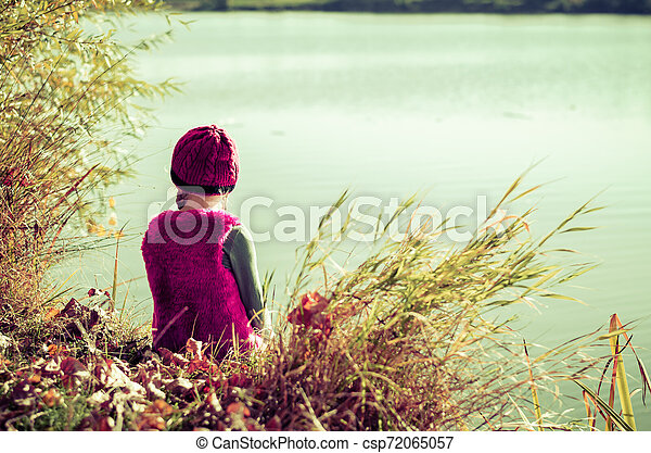 sitting by the pond - csp72065057